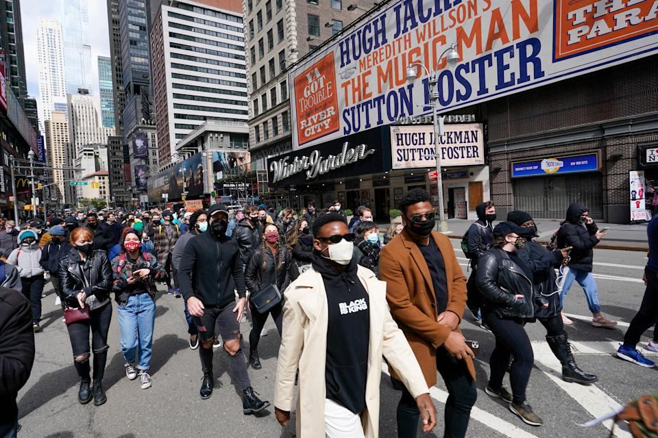 Protesters walk past the Winter Garden Theatre in Times Square during the March on Broadway in April.
