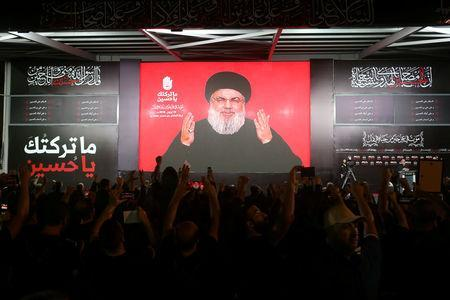 Lebanon's Hezbollah leader Sayyed Hassan Nasrallah gestures as he addresses his supporters via a screen the night before Muslim Shi'ites around the world mark the day of Ashura, in Beirut, Lebanon September 19, 2018. REUTERS/Hasan Shaaban