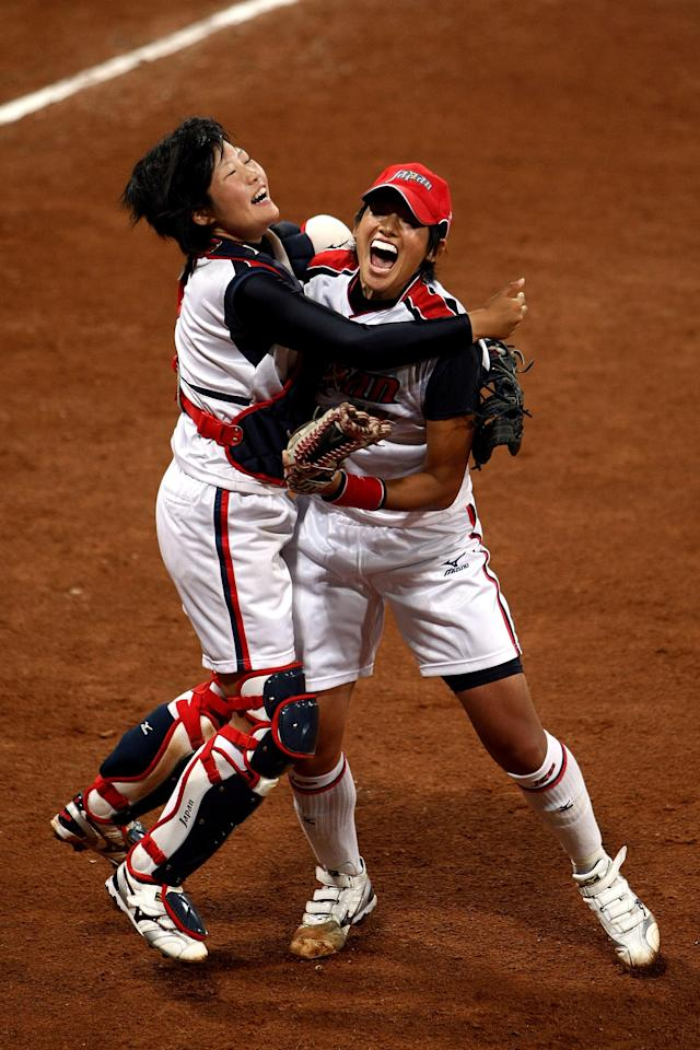 BEIJING - AUGUST 21: Catcher Yukiyo Mine #2 (L) and Yukiko Ueno #17 of Japan celebrate Japan's 3-1 win against the United States during the women's grand final gold medal softball game at the Fengtai Softball Field during Day 13 of the Beijing 2008 Olympic Games on August 21, 2008 in Beijing, China. (Photo by Jonathan Ferrey/Getty Images)