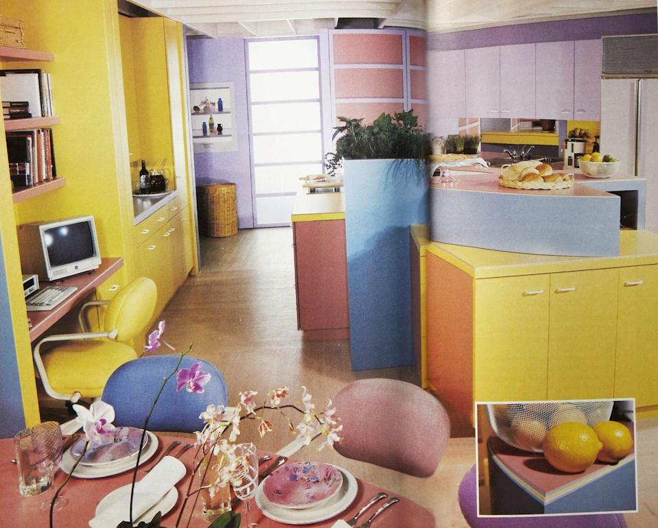 """<p>Just because most homeowners favored black and white appliances doesn't mean everyone eschewed color. Pastels and bright hues are a popular '80s trend that occasionally made its way into the kitchen. Here, the colors also signify the different """"zones"""" for different functions.</p>"""