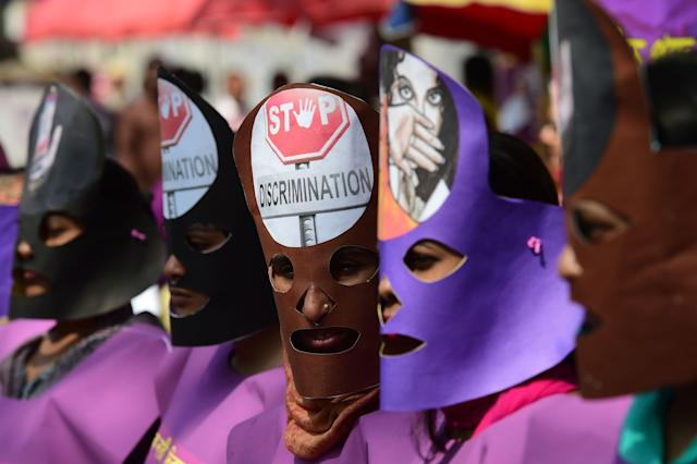 <p>Bangladeshi women wearing masks take part in a rally to mark International Women's Day in Dhaka on March 8, 2018. Thousands of Bangladeshi women, nongovernmental organizations, and rights groups activists took to the streets demanding safer lives for women in the country as well as an improvement in their social conditions. (Photo: Munir Uz Zaman/AFP/Getty Images) </p>