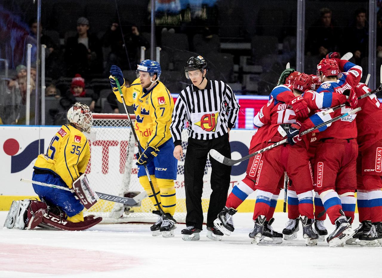 Russia's players celebrate their 2:4 victory against Sweden next to Sweden's Anders Lindback and Henrik Tommernes during the ice hockey match between Sweden and Russia at the Sweden Hockey Games in Scandinavium Arena in Goteborg, Sweden, February 11, 2017. TT News Agency/Bjorn Larsson Rosvall/via REUTERS  ATTENTION EDITORS - THIS IMAGE WAS PROVIDED BY A THIRD PARTY. FOR EDITORIAL USE ONLY. SWEDEN OUT. NO COMMERCIAL OR EDITORIAL SALES IN SWEDEN.