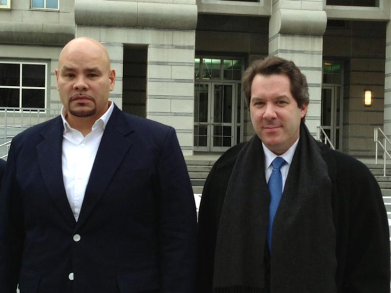 """""""Fat Joe,"""" left, whose real name is Joseph Cartagena, leaves court with his attorney Jeffrey Lichtman in Newark N.J., Thursday, Dec. 20, 2012. The rap star faces up to two years in prison after pleading guilty in federal court to failing to pay taxes on nearly $3 million in income over two years. (AP Photo/Samantha Henry)"""
