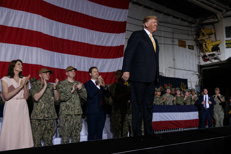 President Donald Trump arrives on stage to speak to troops at a Memorial Day event aboard the USS Wasp, Tuesday, May 28, 2019, in Yokosuka, Japan. (AP Photo/Evan Vucci)