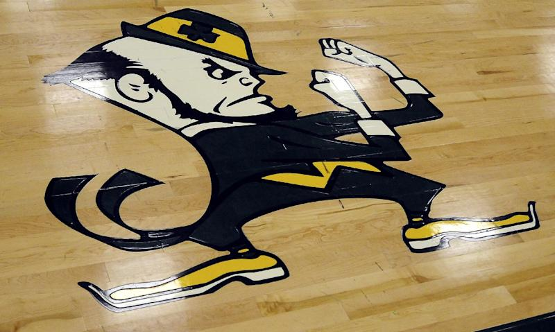 In this photo taken Tuesday, Oct. 18, 2011, the Fighting Irish logo is painted on the gym floor at Chapman Middle School in Chapman, Kan. Chapman schools superindendent Lacee Sell said that the University of Notre Dame told school officials over the summer that the leprechaun is a federally registered trademark that the district is not allowed to use.  (AP Photo/ Salina Journal, Jeff Cooper)