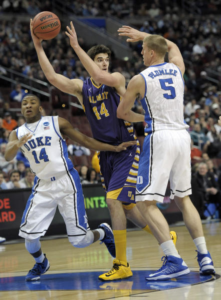 Albany's John Puk, center, tries to pass the ball under pressure from Duke's Rasheed Sulaimon, left, and Mason Plumlee during the first half of a second-round game of the NCAA college basketball tournament, Friday, March 22, 2013, in Philadelphia. (AP Photo/Michael Perez)