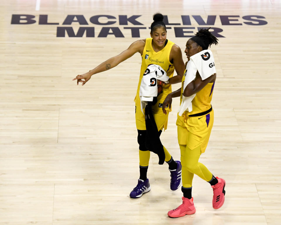 Candace Parker and Nneka Ogwumike walk off the court.