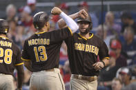 San Diego Padres' Wil Myers, right, celebrates his grand slam with Manny Machado (13) during the second inning of a baseball game against the Washington Nationals, Friday, July 16, 2021, in Washington. (AP Photo/Nick Wass)