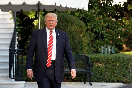 U.S. President Donald Trump walks out from the White House in Washington