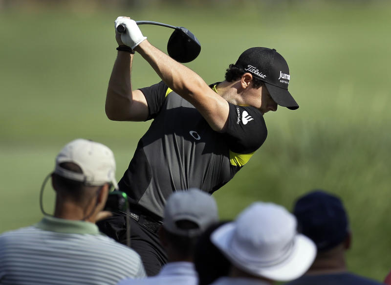 The gallery watches as Rory McIlroy, of Northern Ireland, tees off on the ninth hole during a practice round for The Players Championship golf tournament Tuesday, May 8, 2012, at Sawgrass in Ponte Vedra Beach, Fla. (AP Photo/Chris O'Meara)