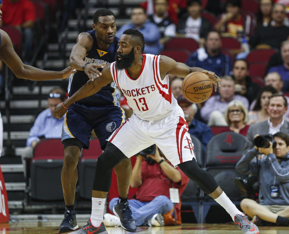 Dec 3, 2014; Houston, TX, USA; Houston Rockets guard James Harden (13) controls the ball during the first quarter as Memphis Grizzlies guard Tony Allen (9) defends at Toyota Center. (Troy Taormina-USA TODAY Sports)