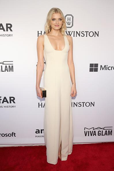 The model who attended the event with Calvin Klein's Francisco Costa, was angelic in an ivory silk V-neck dress from the Pre-Fall 2015 collection. She also carried a Calvin Klein Collection gold metal box clutch.