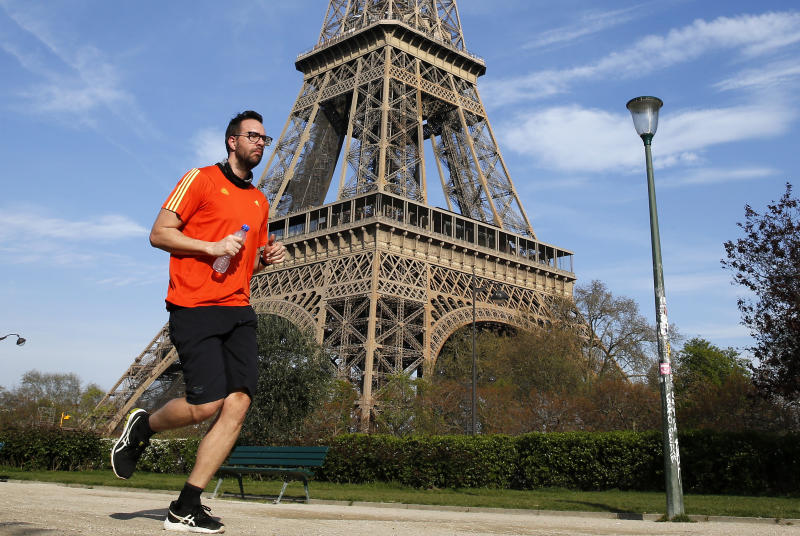 PARIS, FRANCE - APRIL 07: A jogger runs in front of the Eiffel Tower as lockdown continues due to the coronavirus (COVID 19) outbreak on April 7, 2020, in Paris, France. The Paris city hall and the police prefecture have banned jogging in Paris between 10 a.m. and 7 p.m. to stem the Covid-19 epidemic. The country is issuing fines for people caught violating its nationwide lockdown measures intended to stop the spread of COVID-19. The Coronavirus (COVID-19) pandemic has spread to many countries across the world, claiming over 79,000 lives and infecting over 1 million people. (Photo by Chesnot/Getty Images)