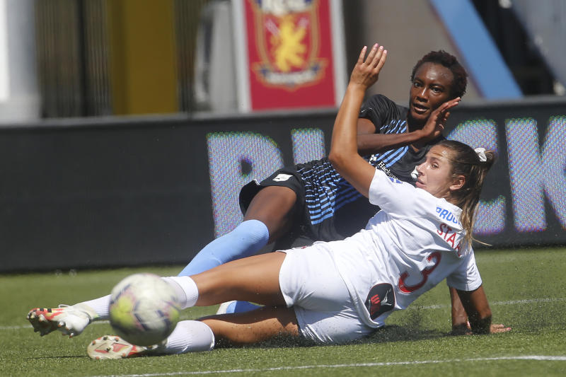 Sky Blue's Ifeoma Onumonu, rear, kicks the ball as Washington Spirit defender Sam Staab (3) defends during the first half of an NWSL Challenge Cup soccer match at Zions Bank Stadium Saturday, July 18, 2020, in Herriman, Utah. (AP Photo/Rick Bowmer)
