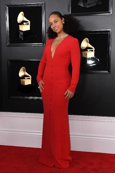 Host US singer-songwriter Alicia Keys looks red-hot in red (AFP Photo/VALERIE MACON)