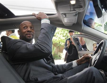 Alonzo Mourning checks the headroom in the new Lincoln MKZ during a Ford event at the Biltmore Hotel in Coral Gables