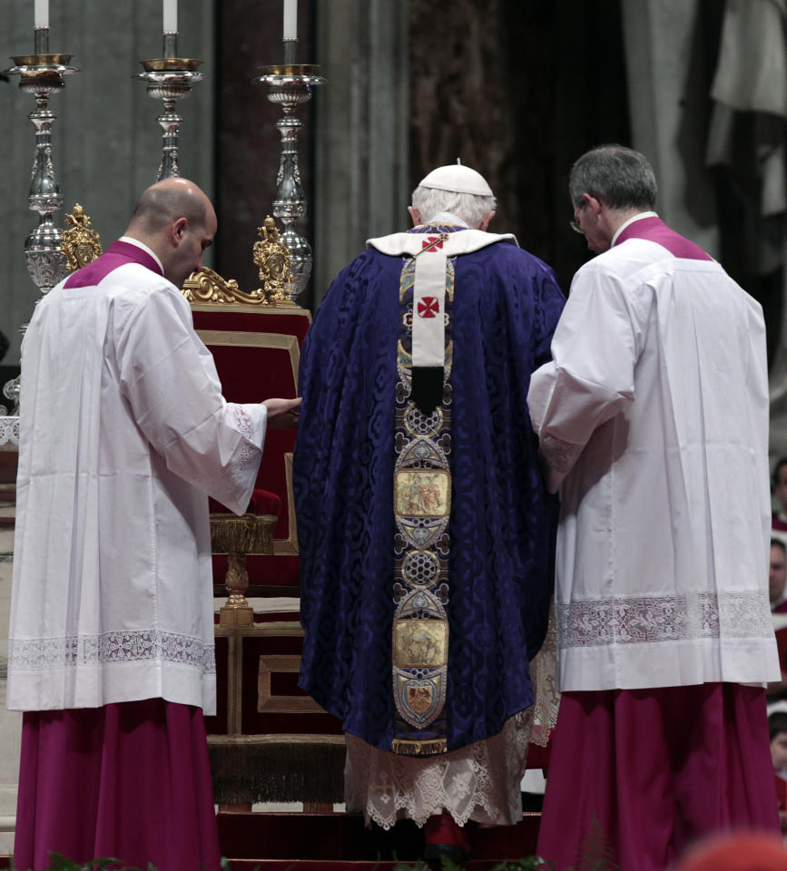 """Pope Benedict XVI is helped by master of ceremonies to walk on the altar as he celebrates the Ash Wednesday mass in St. Peter's Basilica at the Vatican, Wednesday, Feb. 13, 2013. Ash Wednesday marks the beginning of Lent, a solemn period of 40 days of prayer and self-denial leading up to Easter. Pope Benedict XVI told thousands of faithful Wednesday that he was resigning for """"the good of the church"""", an extraordinary scene of a pope explaining himself to his flock that unfolded in his first appearance since dropping the bombshell announcement. (AP Photo/Gregorio Borgia)"""