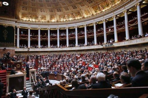 "French Prime Minister Jean-Marc Ayrault addresses Members of Parliament at the National Assembly in Paris. Ayrault on Tuesday urged the French to rally behind efforts to tackle a ""crushing"" debt burden after an audit warned of a 43-billion-euro budget hole"