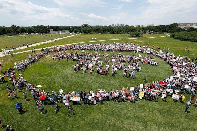 "<p>Protesters encircle a group standing to form letters that spell ""Impeach Trump,"" during a rally to protest President Donald Trump and his policies, on the National Mall, Saturday, June 3, 2017, in Washington. (Photo: Alex Brandon/AP) </p>"