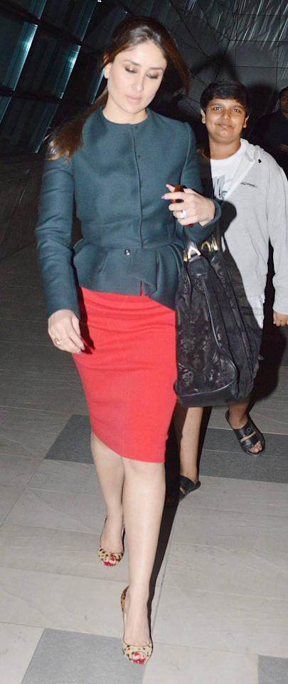This one's an unconventional look for Kareena. But the asymmetrical jacket top, the colour blocked red pencil skirt and leopard print peep toes are all working well together.