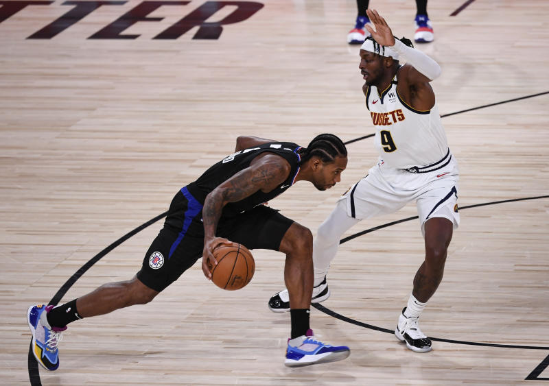 LAKE BUENA VISTA, FLORIDA - SEPTEMBER 03: Kawhi Leonard #2 of the LA Clippers drives the ball against Jerami Grant #9 of the Denver Nuggets during the third quarter in Game One of the Western Conference Second Round during the 2020 NBA Playoffs at AdventHealth Arena at the ESPN Wide World Of Sports Complex on September 03, 2020 in Lake Buena Vista, Florida. NOTE TO USER: User expressly acknowledges and agrees that, by downloading and or using this photograph, User is consenting to the terms and conditions of the Getty Images License Agreement. (Photo by Douglas P. DeFelice/Getty Images)