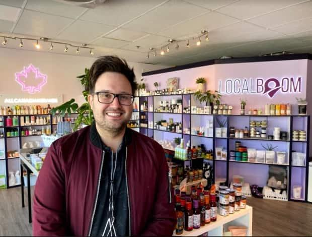 Stephen Kaboom, owner of Local Boom, signed his first lease onan East Vancouver storefront last year just before the start of the pandemic. (Margaret Gallagher/CBC - image credit)