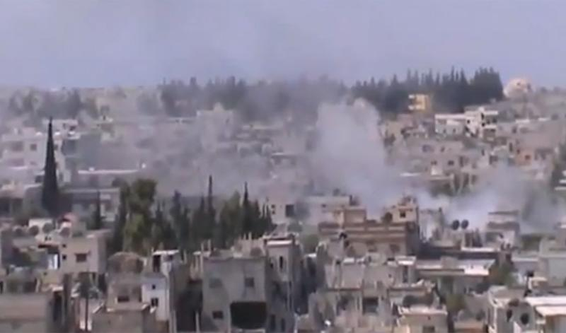 In this image taken from video obtained from the Shaam News Network, which has been authenticated based on its contents and other AP reporting, smoke rises from buildings from heavy shelling in Homs, Syria, on Thursday, Dec. 27, 2012. (AP Photo/Shaam News Network via AP video)