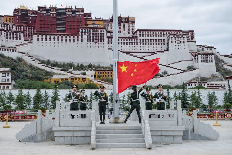 The Chinese national flag is raised at Potala Palace in Lhasa