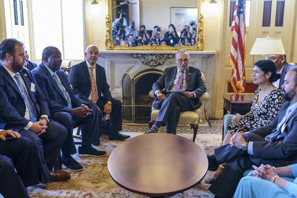 Senate Majority Leader Chuck Schumer, D-N.Y., joined by Rep. Chris Turner, left, chairman of the Texas House Democratic Caucus, meets with Democratic members of the Texas Legislature who are trying to kill a Republican bill in Austin that would make it harder to vote in the Lone Star State, at the Capitol in Washington, Tuesday, July 13, 2021. (AP Photo/J. Scott Applewhite)