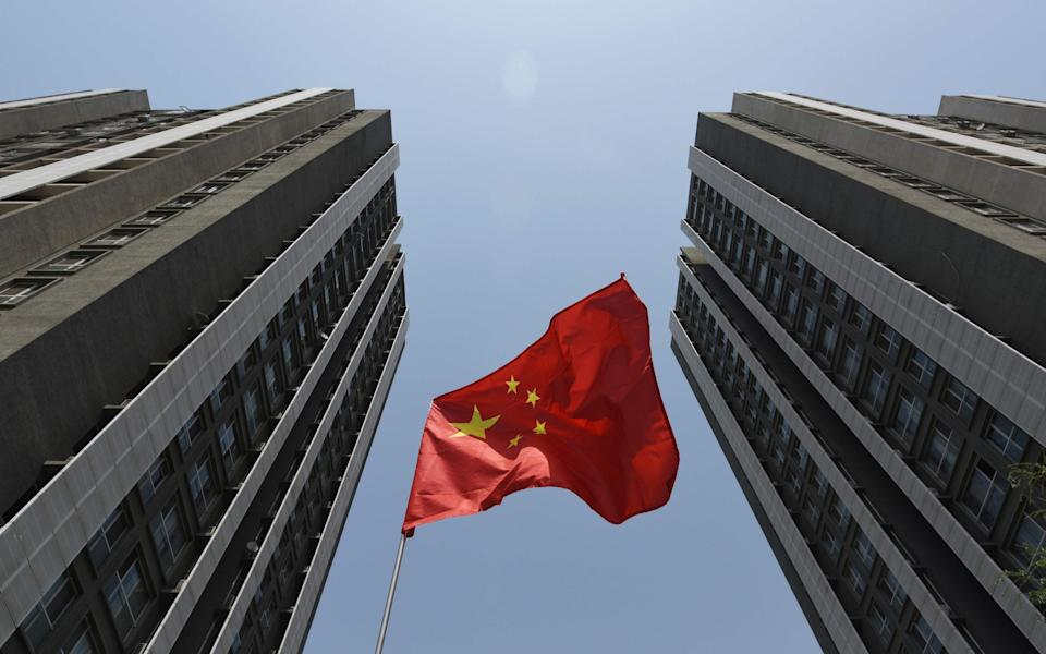 China's economy stumbles as trade war pressure grows