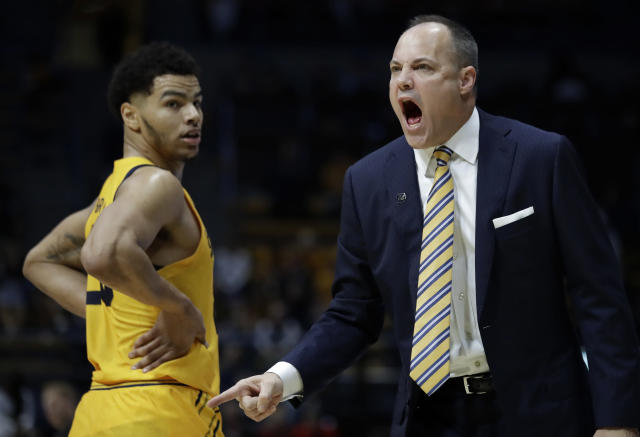 California coach Mark Fox, right, yells to players beside Matt Bradley, left, in the first half of an NCAA college basketball game against Arizona, Thursday, Feb. 13, 2020, in Berkeley, Calif. (AP Photo/Ben Margot)