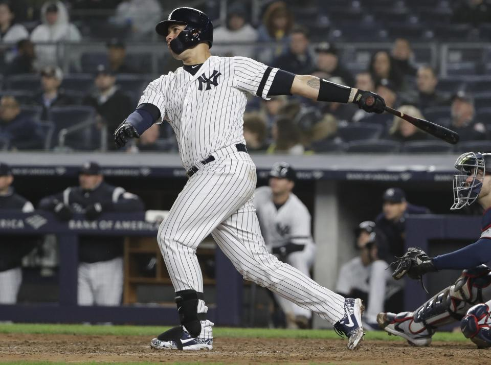 New York Yankees' Gary Sanchez follows through on a home run during the seventh inning of the team's baseball game against the Minnesota Twins on Friday, May 3, 2019, in New York. (AP Photo/Frank Franklin II)