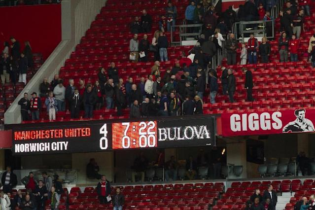 The scoreboard is seen after a 4-0 win over Norwich City for Manchester United's interim manager Ryan Giggs in their English Premier League soccer match at Old Trafford Stadium, Manchester, England, Saturday April 26, 2014. (AP Photo/Jon Super)