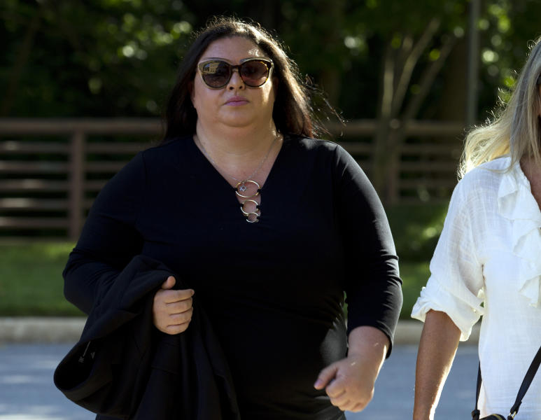 "Lee Elbaz arrives at federal court for jury selection in her trial in Greenbelt, Md., Tuesday July 16, 2019. Elbaz was CEO of an Israel-based company called Yukom Communications. She is accused of engaging in a scheme to dupe investors through the sale and marketing of financial instruments known as ""binary options."" (AP Photo/Jose Luis Magana)"