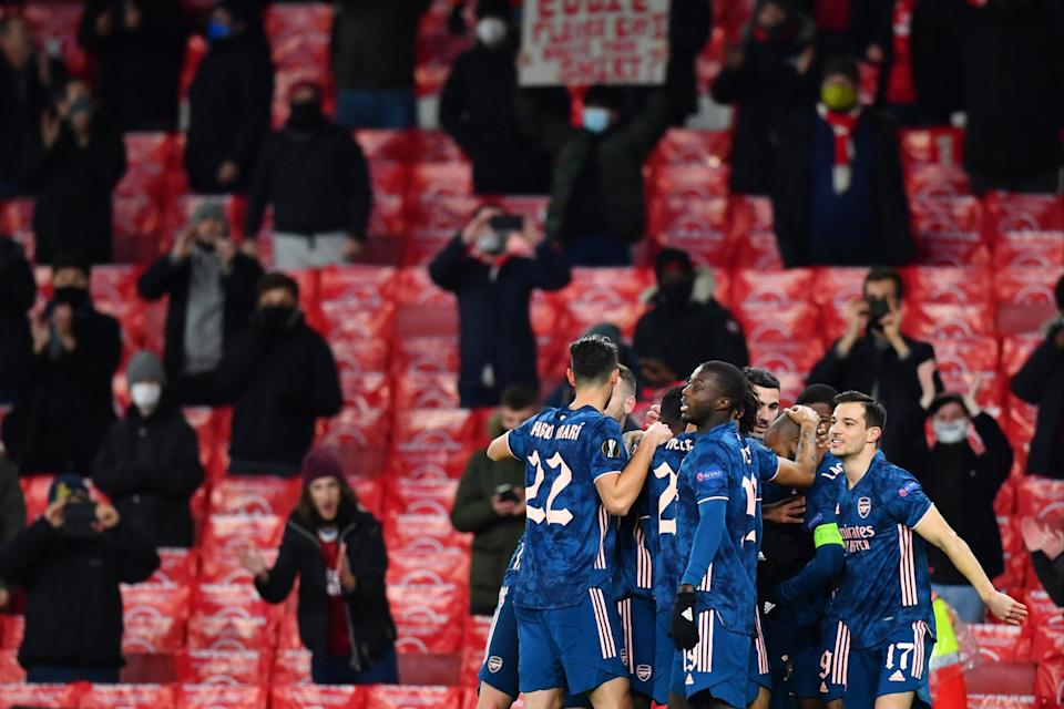 <p>Cheer: Arsenal were in the mood in front of spectators</p> (REUTERS)