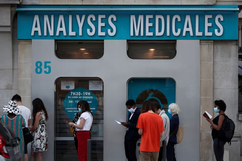 People queue to enter a laboratory to get tested for the coronavirus disease (COVID-19) in Neuilly-sur-Seine, near Paris