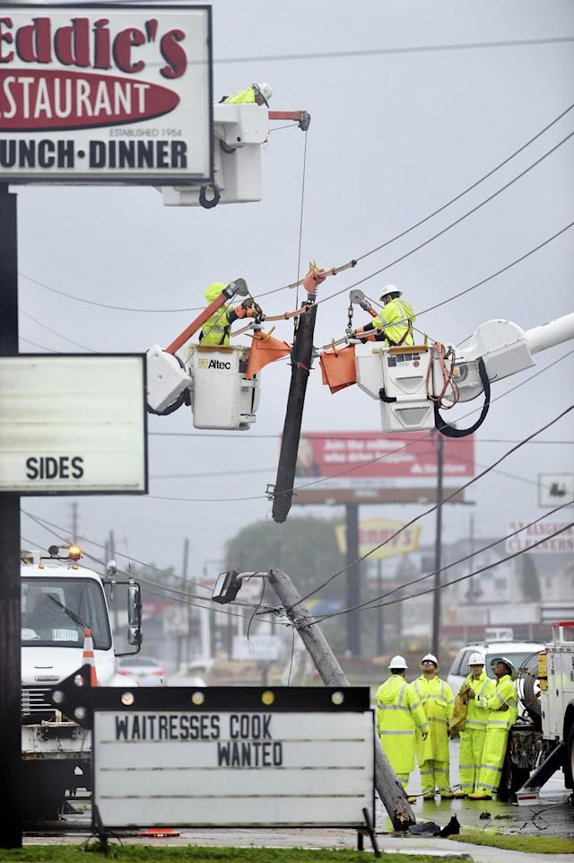 <p>Gulf Power employees repair a power pole that snapped, June 21, 2017, in Fort Walton Beach, Fla. A line of severe weather from Tropical Storm Cindy battered this northwest Florida community early Wednesday morning. (Photo: Devon Ravine/Northwest Florida Daily News via AP) </p>