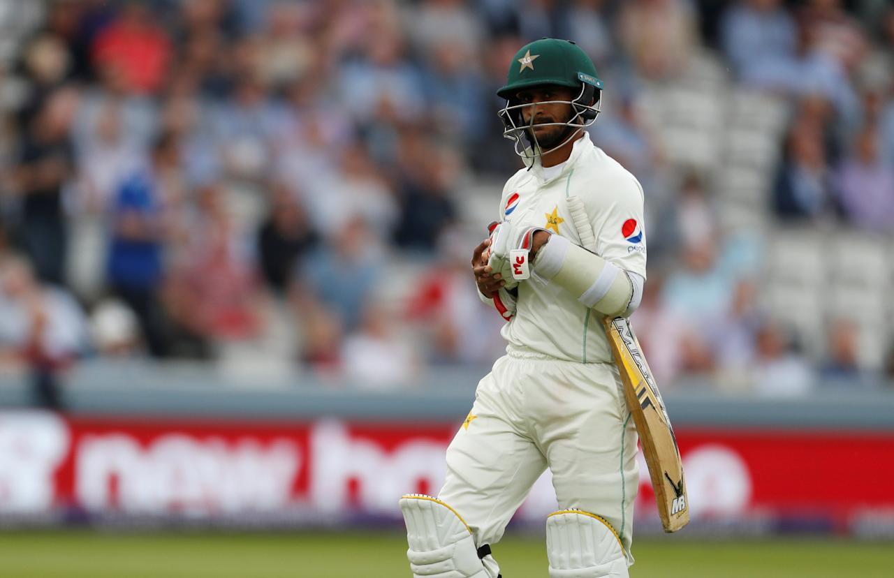 Cricket - England vs Pakistan - First Test - Lord's Cricket Ground, London, Britain - May 25, 2018   Pakistan's Hasan Ali walks off dejected after losing his wicket   Action Images via Reuters/John Sibley