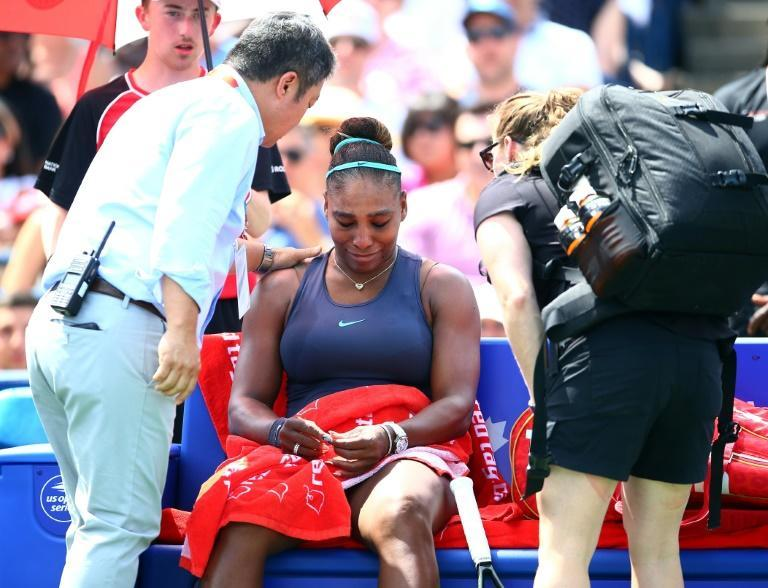 Early exit: Serena Williams can't fight back tears as she withdraws from the WTA Toronto final with back spasms (AFP Photo/Vaughn Ridley)