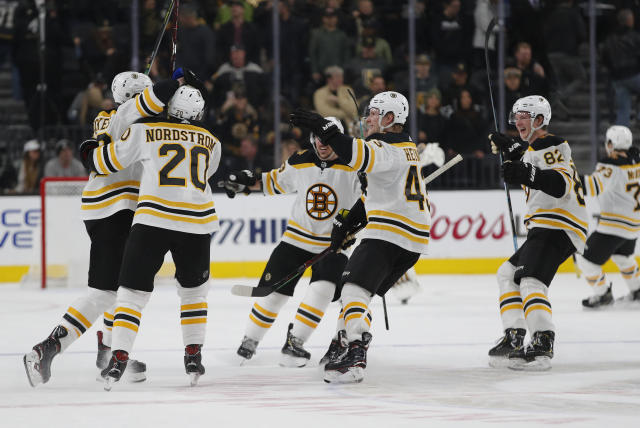 Boston Bruins celebrate after right wing David Backes, left, scored against the Vegas Golden Knights during the shootout in an NHL hockey game Wednesday, Feb. 20, 2019, in Las Vegas. The Bruins won 3-2. (AP Photo/John Locher)