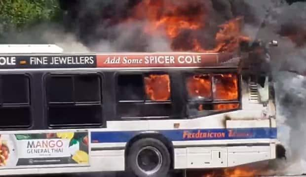 Fredericton Fire Department crews responded to a city transit bus on fire on Two Nations Crossing Tuesday afternoon. (Facebook/Alexander Bakr - image credit)