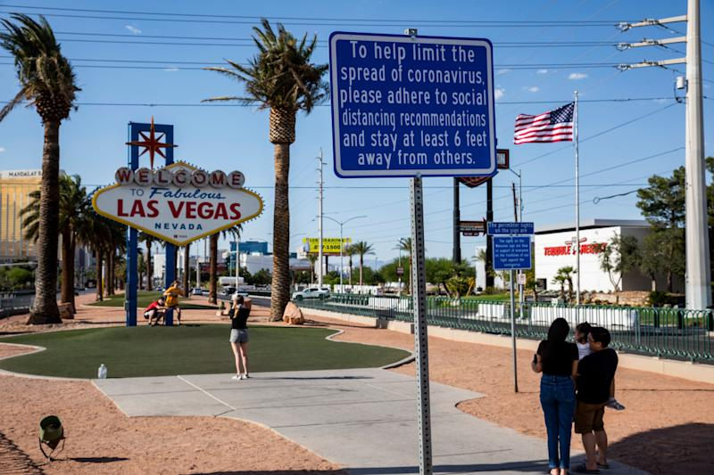 Signs now posted in many parts of Las Vegas stress the recommended social distancing to help stem the coronavirus pandemic. (Photo: Joe Buglewicz for HuffPost)