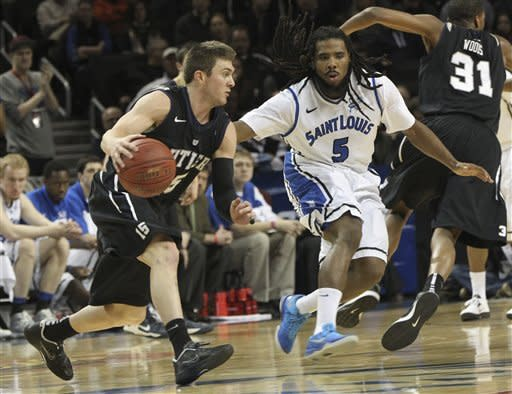 Butler's Rotten Clarke, left, drives past Saint Louis' Jordair Jett during the first half of an NCAA college basketball game in the semifinals of the Atlantic 10 Conference tournament, Saturday, March 16, 2013, in New York. (AP Photo/Mary Altaffer)