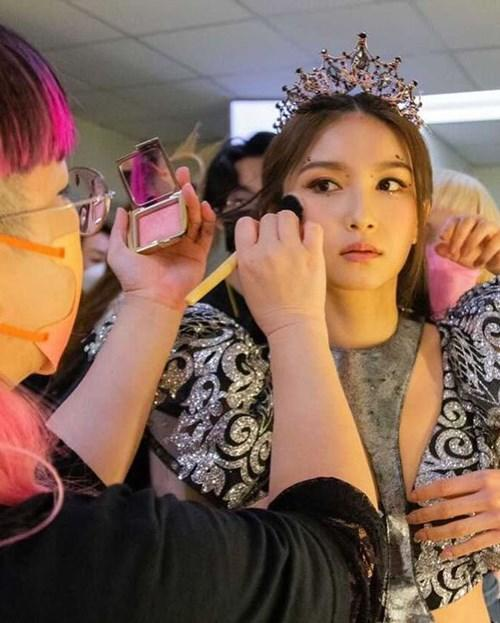 Getting the final touch-ups before the pageant