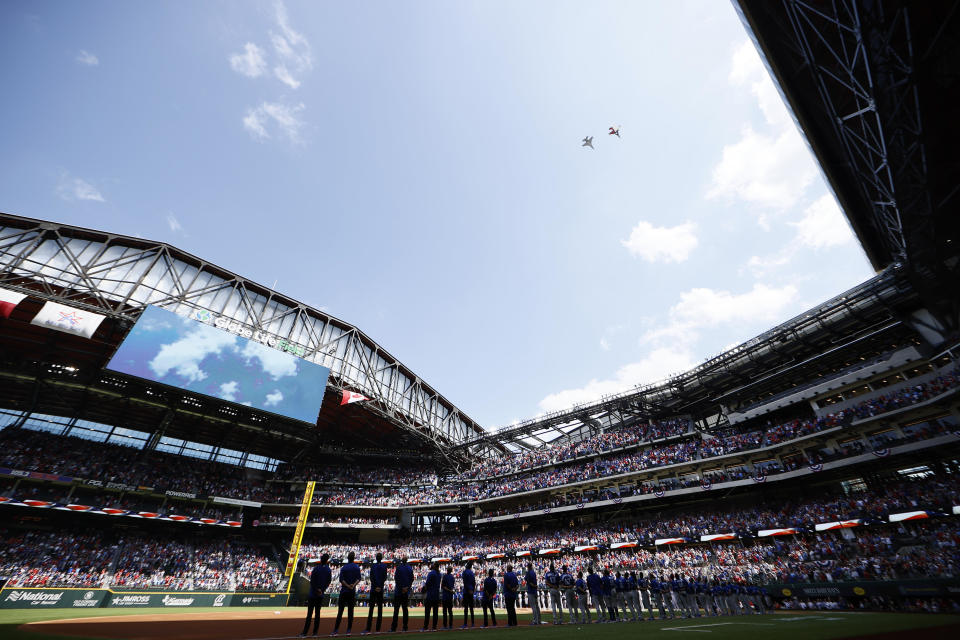 F-16 fighter jets perform a flyover during the National Anthem before the Texas Rangers take on the Toronto Blue Jays on Opening Day at Globe Life Field on Monday. / Credit: / Getty Images