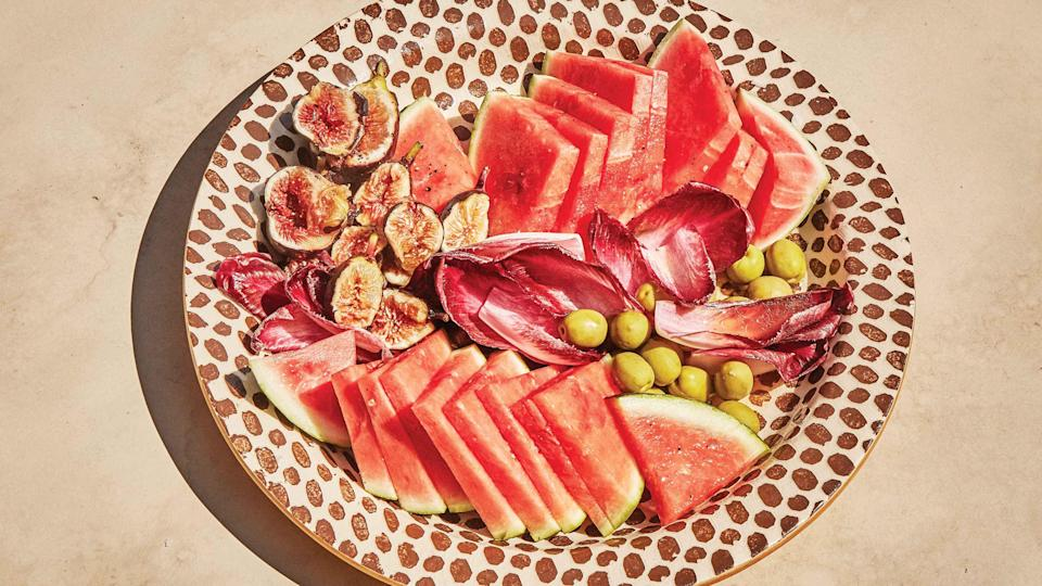 "Less of a recipe and more of a serving suggestion, this combination of sweet and salty flavors and crunchy and juicy textures is the perfect side salad or a cocktail hour snack platter. The contrasting ingredients are united by a super simple lemon vinaigrette and, of course, a sprinkle of flaky salt. <a href=""https://www.bonappetit.com/recipe/watermelon-endive-and-fig-salad?mbid=synd_yahoo_rss"" rel=""nofollow noopener"" target=""_blank"" data-ylk=""slk:See recipe."" class=""link rapid-noclick-resp"">See recipe.</a>"