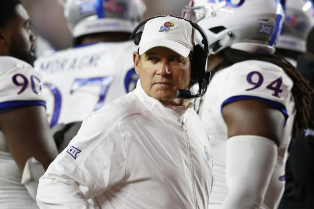 Kansas head coach Les Miles stand swith his team during a timeout in the second half of an NCAA college football game against Boston College in Boston, Friday, Sept. 13, 2019. (AP Photo/Michael Dwyer)
