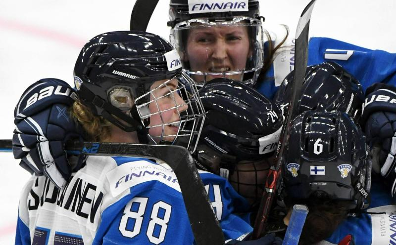 Goal scorer Finland's Ronja Savolainen, left, celebrates after scoring with teammates Rosa Lindstedt, Noora Tulus and Jenni Hiirikoski during the IIHF Women's Ice Hockey World Championships semifinal match between Canada and Finland in Espoo, Finland, Saturday, April 13, 2019. (Jussi Nukari/Lehtikuva via AP)