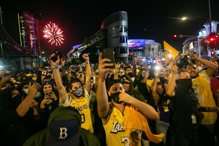 LOS ANGELES, CA - OCTOBER 11: Los Angeles Lakers fans gather near the Staples Center to celebrate the Lakers 106 - 93 game 6 over the Miami Heat on Sunday, Oct. 11, 2020 in Los Angeles, CA. (Jason Armond / Los Angeles Times)