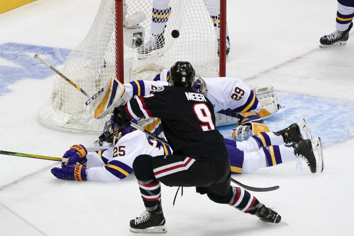 St. Cloud State's Spencer Meier (9) scores on Minnesota State goaltender Dryden McKay (29) during the first period of an NCAA men's Frozen Four hockey semifinal in Pittsburgh, Thursday, April 8, 2021. (AP Photo/Keith Srakocic)